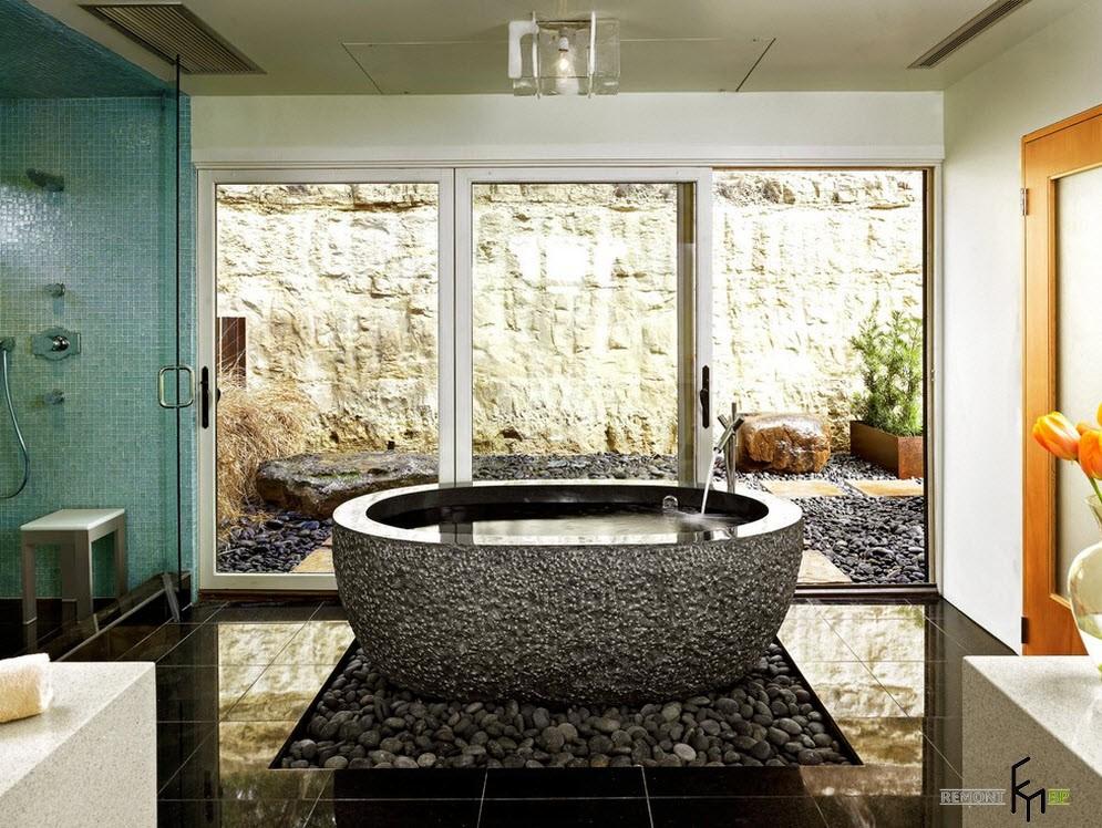 Использование морской гальки будет смотреться наиболее гармонично в ванной комнате как в качестве декора, так и напольного покрытия